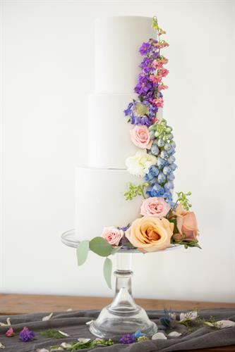 Multi-tiered wedding cake with flower details