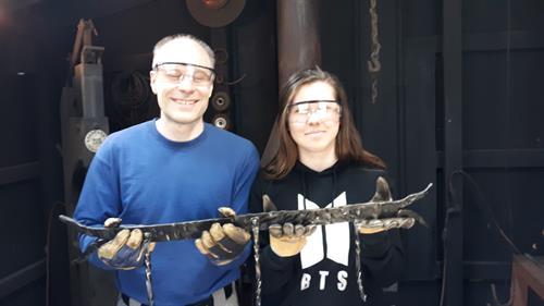Ben and his daughter Melana make a coat rack.