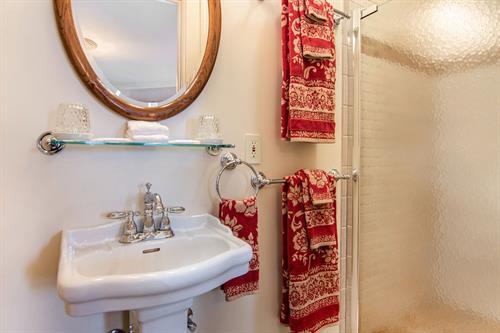Gallery Image Lamplighter-BNB-Crosby-Fireplace-Room-Bathroom-Pedestal-Sink.jpg