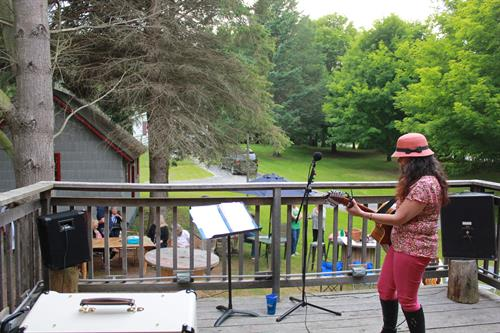 Cheyl Wolfram performing on the Deck at the Shagway Arts Barn