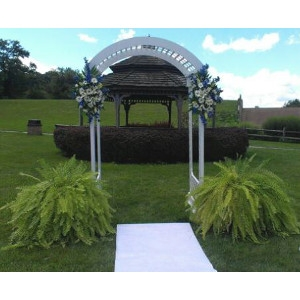 Our Wedding Arch, which really pops with your color choice of flowers and ribbons