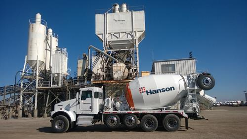 Hanson Ready Mix Truck in front of a Concrete Batch Plant
