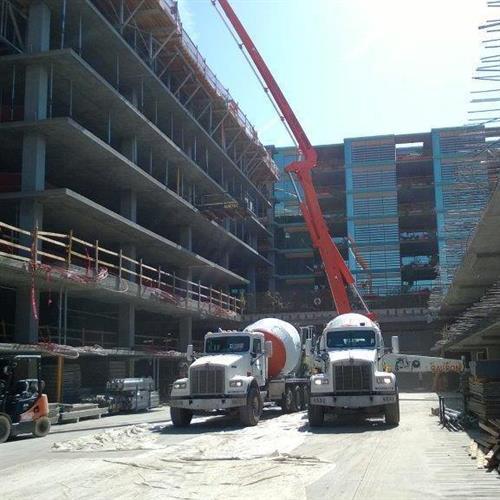 Hanson Ready Mix Truck sending concrete up the high rise