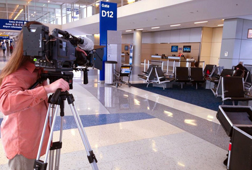Filming video for Texas Sky air service at the DFW airport