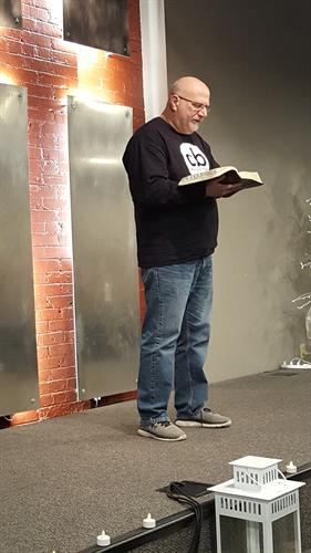 Pastor Jim teaching from the Bible