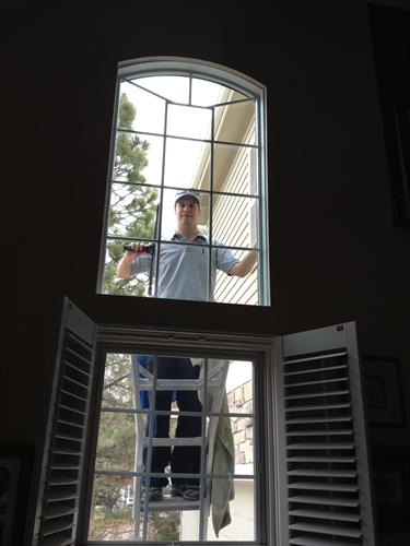 Nick on a ladder cleaning