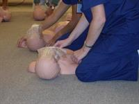 Nursing Assistant students learning CPR