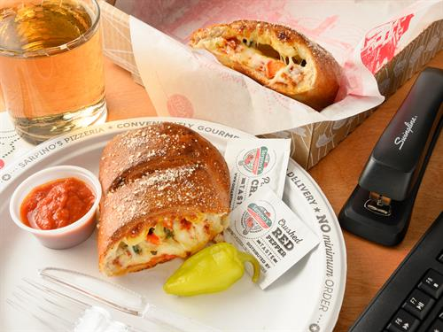 Gallery Image Calzone_lunch_lifestyle.jpeg