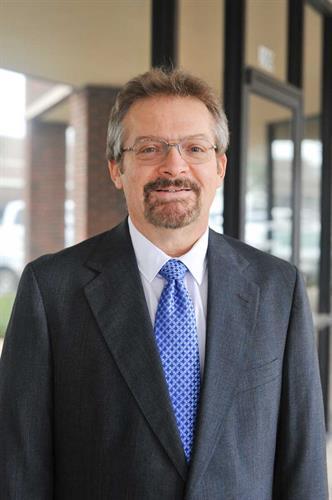 Dr. Neal Blauzvern