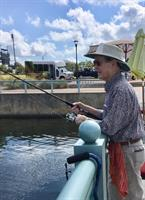 Wesley Haven Villa Resident Enjoys Fishing in the Bay!