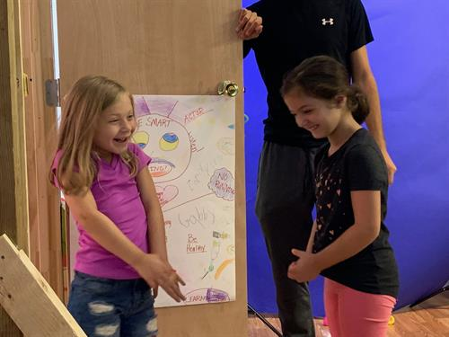 Young Actors doing acting games with a special guest teacher