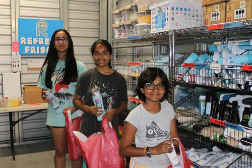 Volunteers packing Refresh Packs in our storage facility