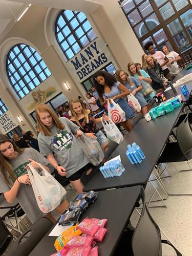 Local HS Volleyball team hosted a hygiene product drive!