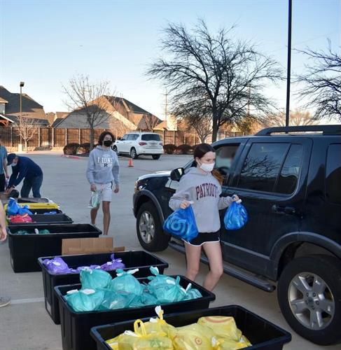 Drive-thru hygiene pack distribution
