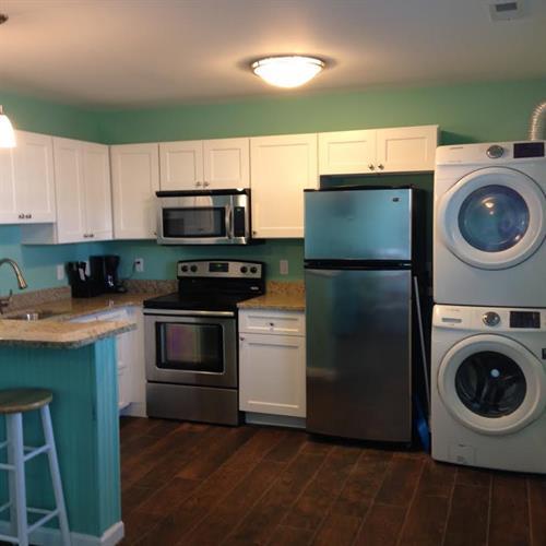 Kitchen with pots & pans, basic utensils, washer/dryer, dishwasher