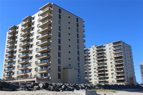 The Shores Condominium.  A twelve story condominum building consisting of two towers located on the beach in Monmouth Beach, NJ.  Work includes the preparation and application of an elastomeric coating to the entire exterior brick facade.  Work also includes the removal of tile flooring on all unit balcony deck tops and the application of a new polyurethane deck coating.