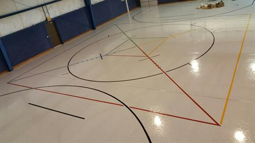 Resinous flooring with line striping
