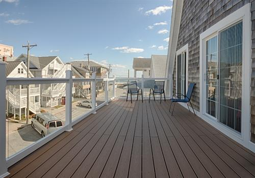 Bungalow 8 ~ 3rd floor deck on the North Side.  Glass walls & an OCEAN VIEW!