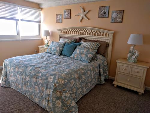 Awaken in the oceanfront master bedroom to the sound of the waves crashing on the beach. TV , DVD player in room
