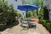 Cottage 1 and 2 shared back patio, each unit gets a table, umbrella and 4 chairs