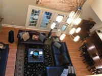 Main House view of family room from upstairs landing