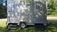 Dark Executive Luxury Restroom Trailer