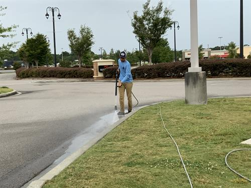 Cleaning curbs and sidewalks