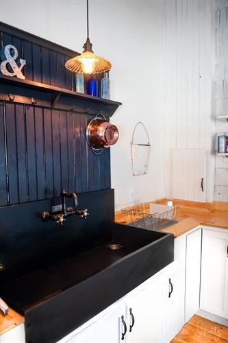 Beautifully restored Monson slate sink is a guest favorite in the kitchen