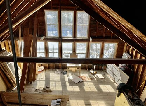OPENING JUNE 1. Top down view from the 3rd story loft into living area.