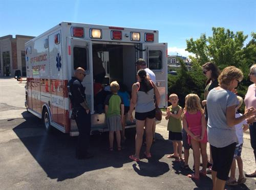 Getting an up close look at an ambulance at Touch the Trucks!