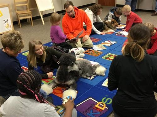 Children reading to therapy dogs!