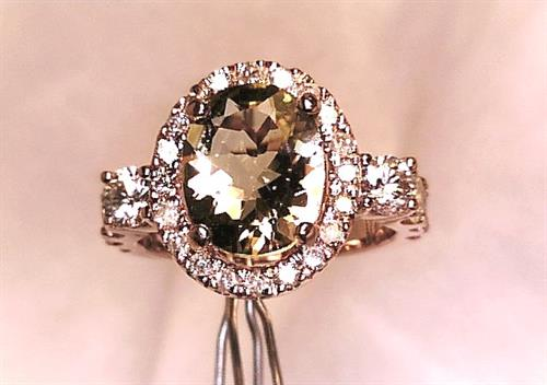 Custom Made Rose Gold diamond and Morganite Halo ring.