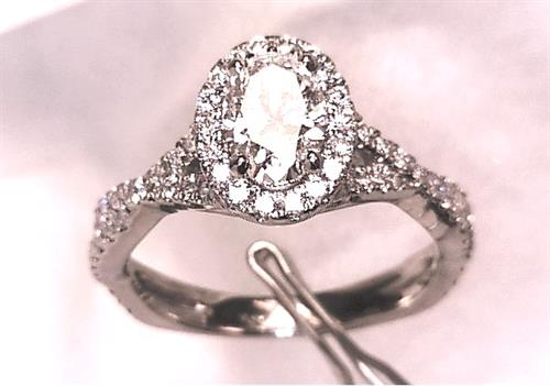 Custom Designed and Hand Made 14k White Gold Engagement Ring Set with a 1.01 Ct. GIA Oval Center and all F VS1 Diamonds