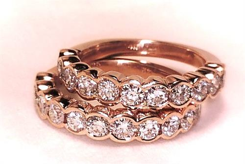 Custom Designed 14k Rose Gold matching wedding bands set with F Volor VS1 diamonds.