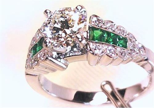 Custom Designed and Hand Made Platinum Engagement set with Zambian Emeralds.