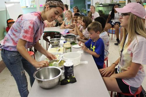 Summer campers learning to cook in Garden Kitchen!