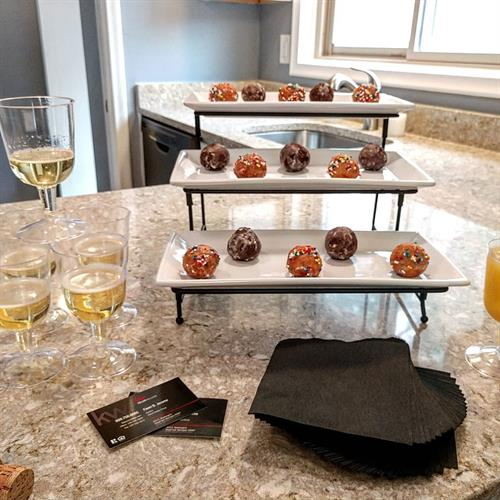 Doughnut holes and mimosas prove to be a neighborhood favorite at open houses.