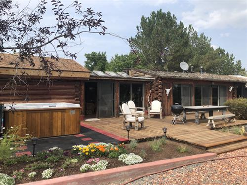 The Back Patio offers a great place to relax outside, enjoy the hot tub, barbecue, and have a meal under the big sky with a serene view of the English Garden.