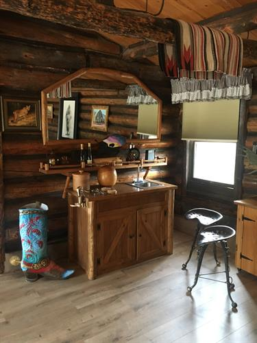 The authentic old-style Western Bar brings charm to the living room space.