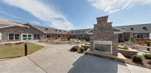 Open Courtyard offers an outdoor fireplace, waterfall, playground and covered picnic area for a rejuvenating experience.