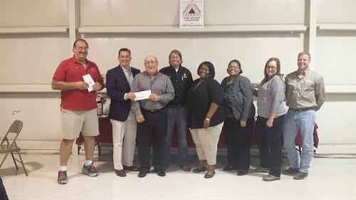 SLHBA Board presenting the Haven with a donation.