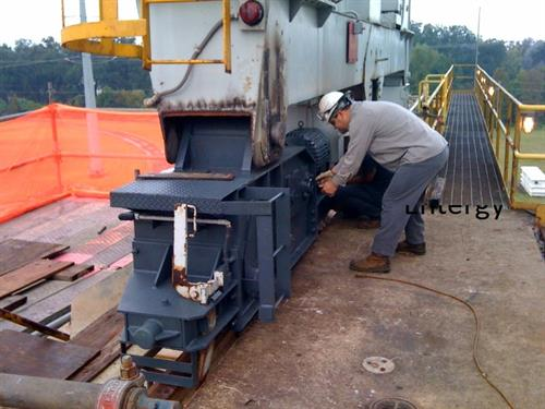 Reverse engineered end trucks for large gantry crane at a power plant