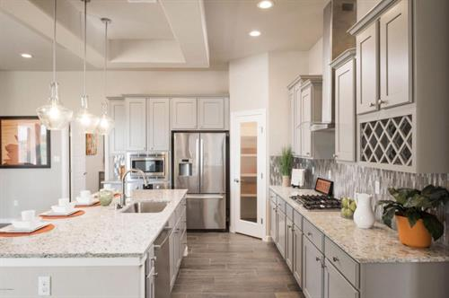 Kitchen with Granite Counter tops, Stainless Appliances and Wine Rack