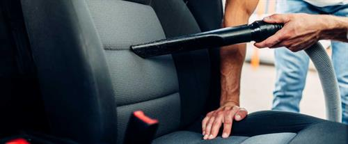 Gallery Image man-cleans-car-interior-with-vacuum-cleaner-ps78b2n.jpg