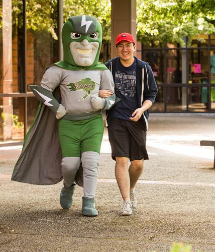 """Chemeketa's mascot, """"Bolt"""" with Chemeketa student"""