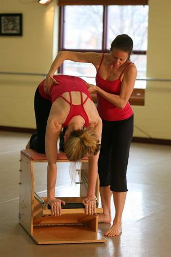 "Alexandra Jerkunica instructing pilates chair , ""catback"""