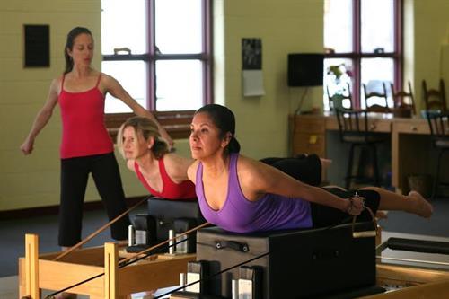 "Alexandra Jerkunica instructing Pilates Reformer, ""Pull Straps"""