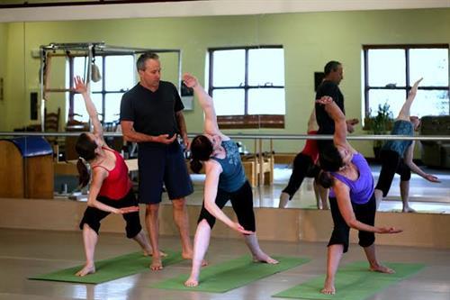 Anthony Jerkunica instructing Yoga