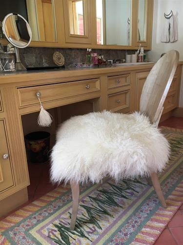 Mongolian sheepskin on vanity chair