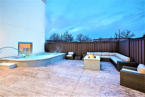 Gallery Image LGUDAHX_Hampton_Inn_and_Suites_Logan_Patio_and_Indoor_-_Outdoor_Hot_Tub.jpg